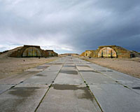 Aircraft shelters alongside the runway