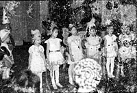 Found photograph, little girls dressing like butterflies singing for Christmas